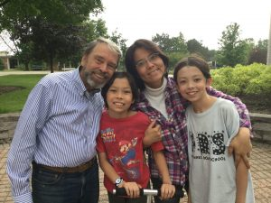 Pearce Church partners Chris and Yuko Wilkins and family, Japan